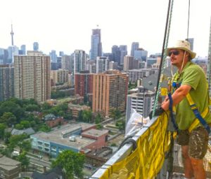 muralform founder, jason rouleau, painting the worlds tallest mural in Toronto