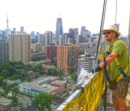 Jason Rouleau, MuralForm founder, painting the worlds tallest mural