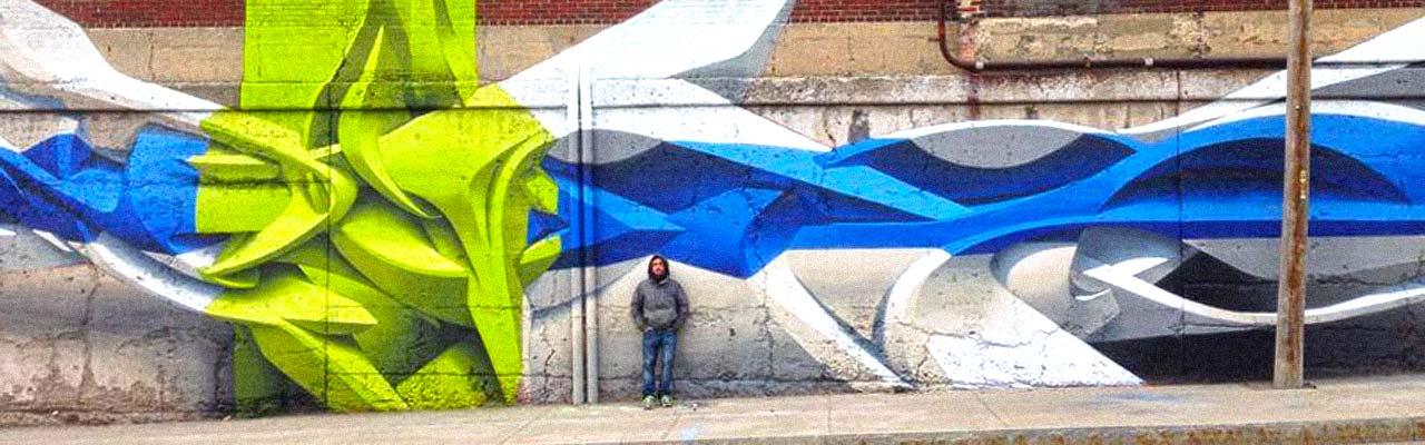peeta infront of mural