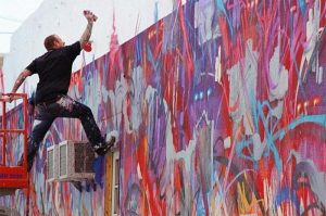 picture of the artist saber while spray painting street art