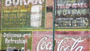 examples of ghost signs on side of buildings