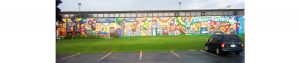 massive exterior mural painted on the crayola factory