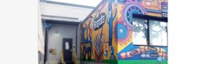 close up of crayola factory mural next to loading dock area