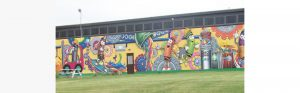close up of mural painted on crayola factory with many crayola marker characters