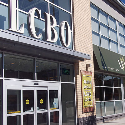 front of lcbo featuring hand-painted sign
