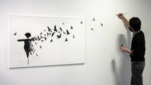 pejac working on painting