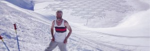 simon beck standing infont of his snow art