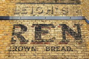 old signage on building brick, very faded
