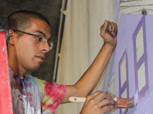 artist antonio ramos painting a mural