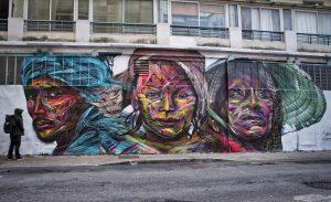 hopare artowrk on the street showcasing three faces