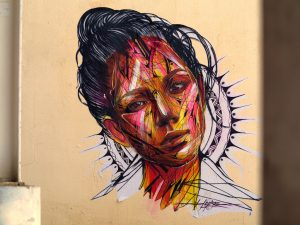colourful face mural by artist hopare