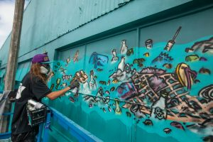 sea walls mural being painted by mural artist in napier new zealand