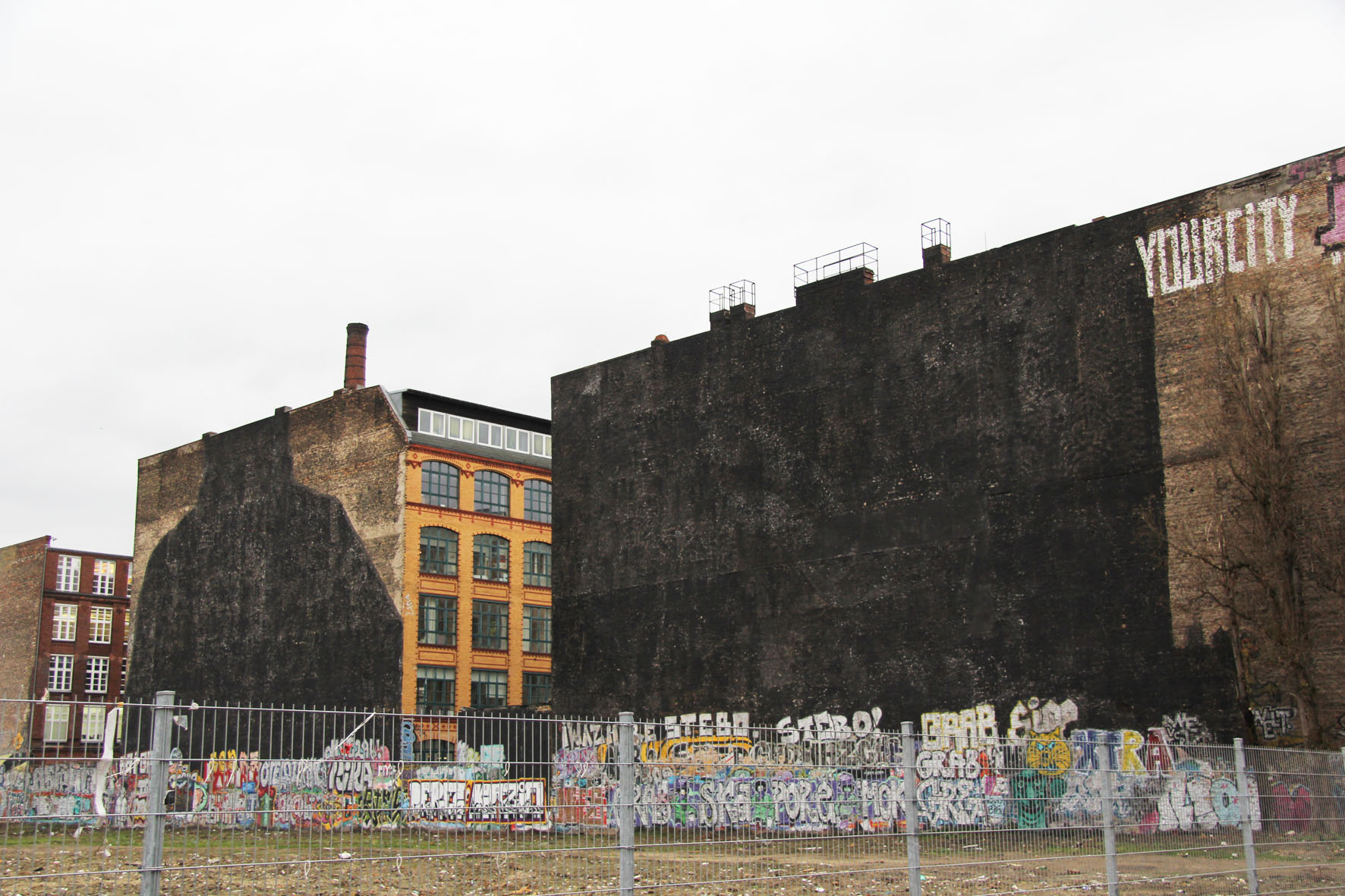 image of blu mural in berlin after being painted over