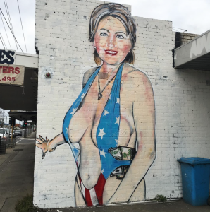 hillary clinton mural wearing star spangled bathing suit with cash