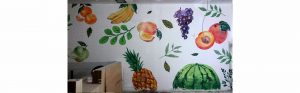 bubble tea mural with various fruits and vegetables visible featuring grapes and watermelon