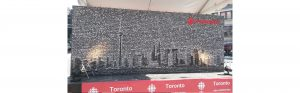close up view of cbc toronto mural featuring collage of faces forming the toronto city skyline