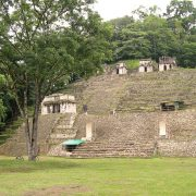 a view of the exterior of bonampak site, an ancient and majestic temple is visible
