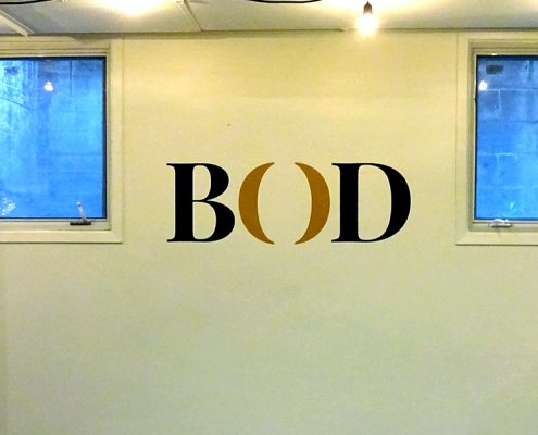 close up of interior painted signage featuring the bod logo