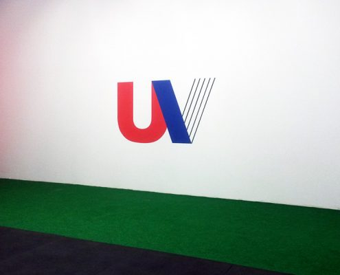 ua logo painted on the inside of the gym wall