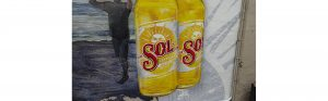 close up of two bottles of sol hand painted in the sol advertisement mural located in gabby's restaurant