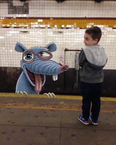 subway doodle by ben rubin showing a young boy and a playful rat beast