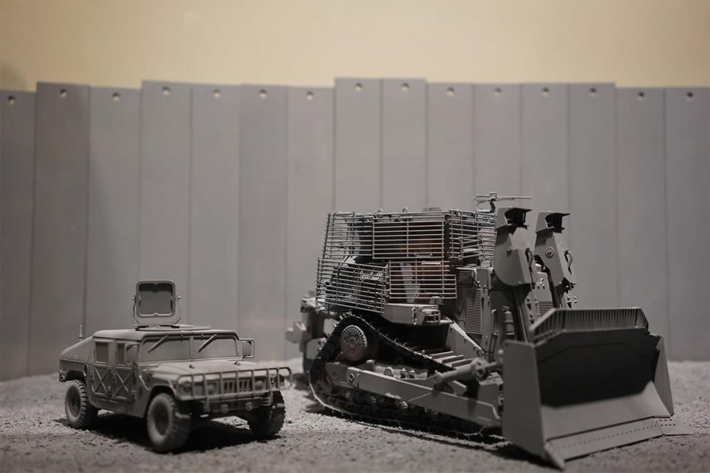 model depiction of construction vehicles during the creation of the wall as seen inside of the walled off hotel