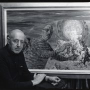 harry sternberg sitting infront of a self portrait